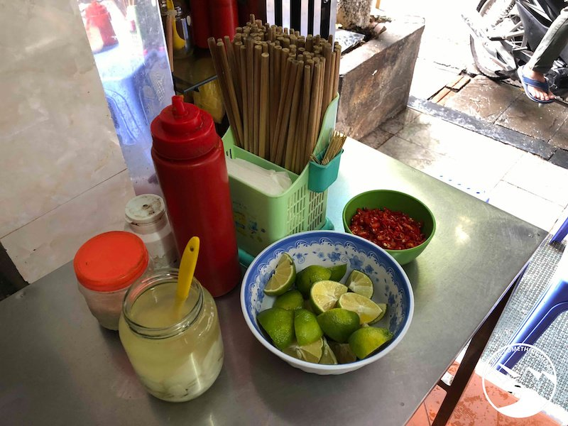 garlic, lime and chili are traditional toppings for Pho Bo in Hanoi Vietnam
