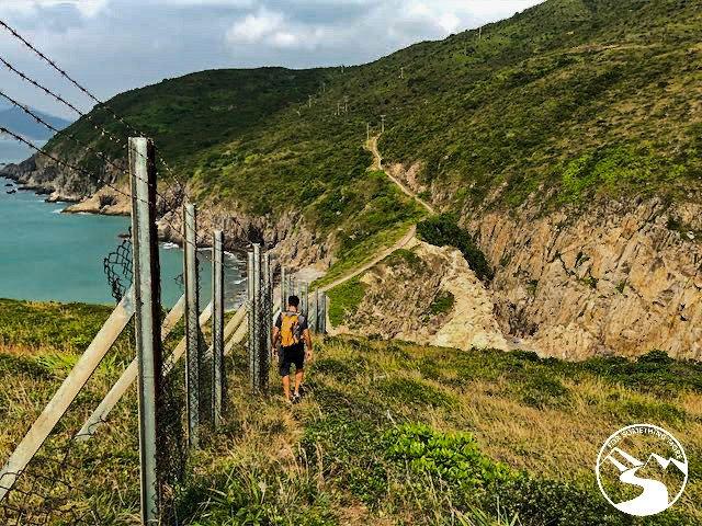 hiking along a fence