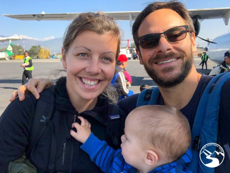 A family boarding a flight to Pokhara Nepal