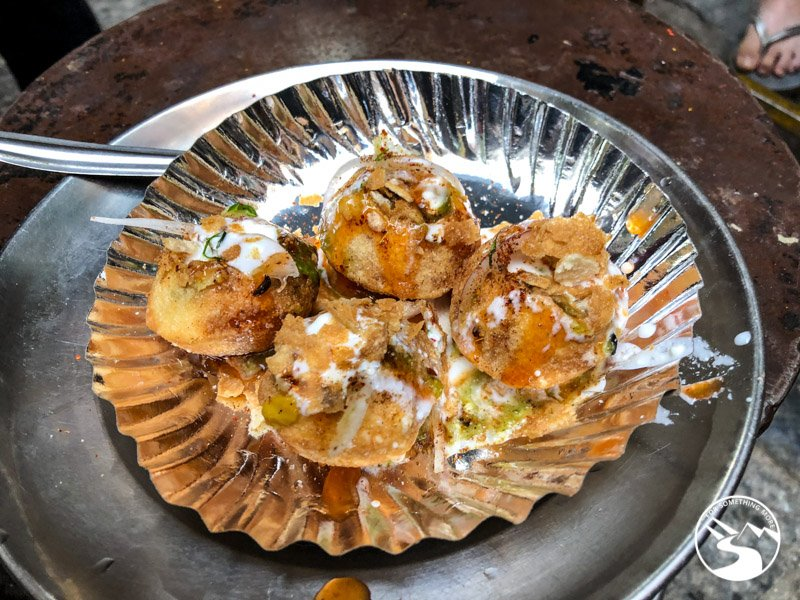 dhai puri on a metal plate