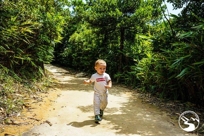 boy running on trail