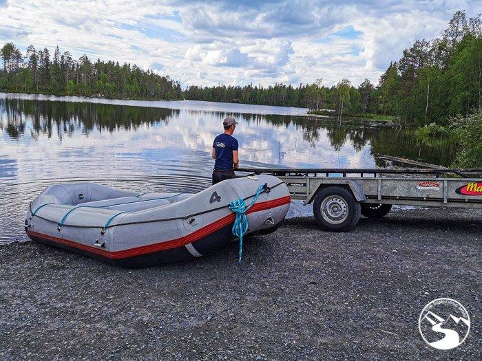 man preparing white water rafting boat