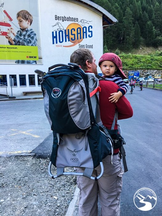 A dad Heading to the gondola station while Hiking In Switzerland With Kids