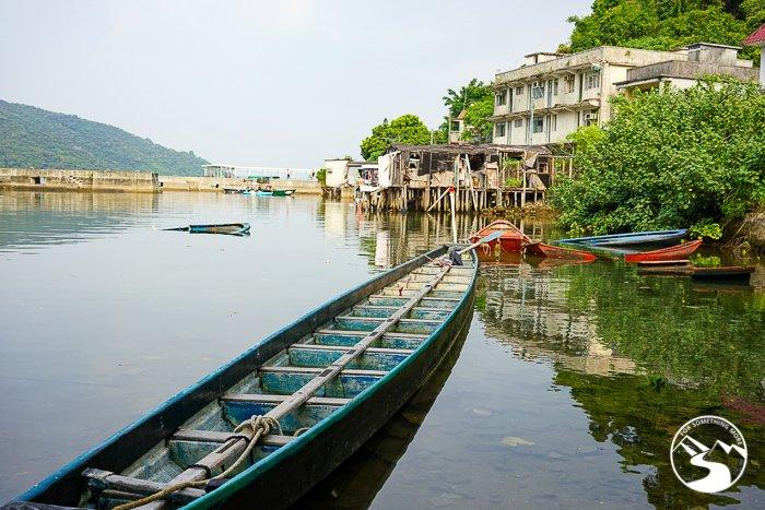 a dragon boat in a bay