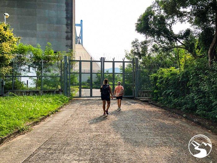 two women walking under the Tsing Ma Bridge