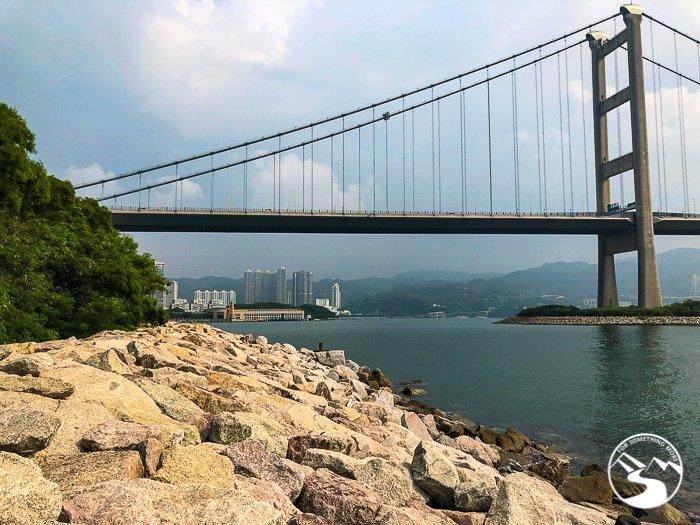 a rock path extending under the Tsing Ma Bridge