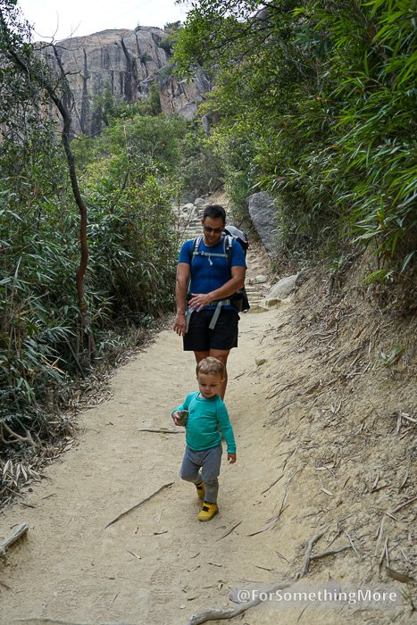 man hiking with son