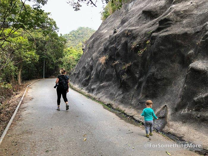 boy and woman walking up road to Tai Lam Chung Reservoir (大欖涌水塘 千島湖) Thousand Island Hike
