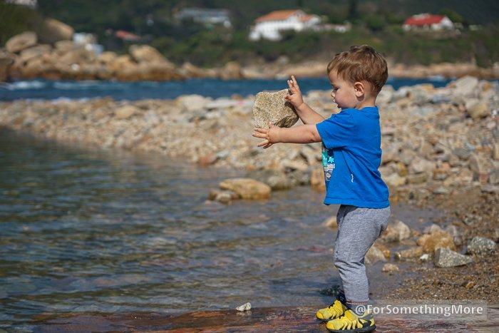 boy throwing rock