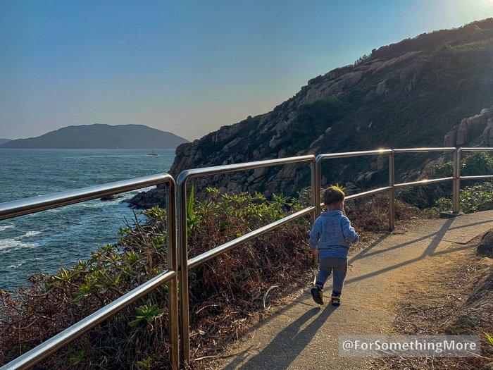 boy walking on island hiking trail