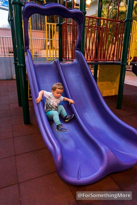 toddler going down slide