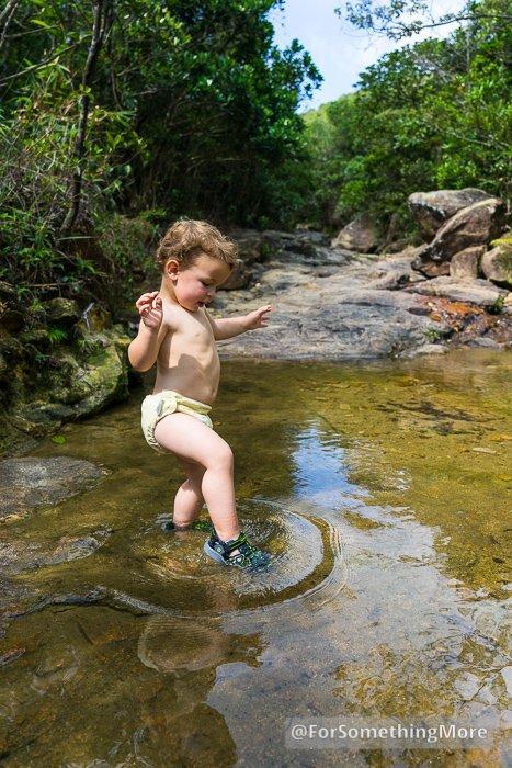 toddler sandals on boy's feet in stream