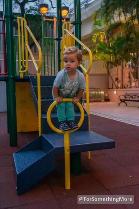 Toddler playing on playground