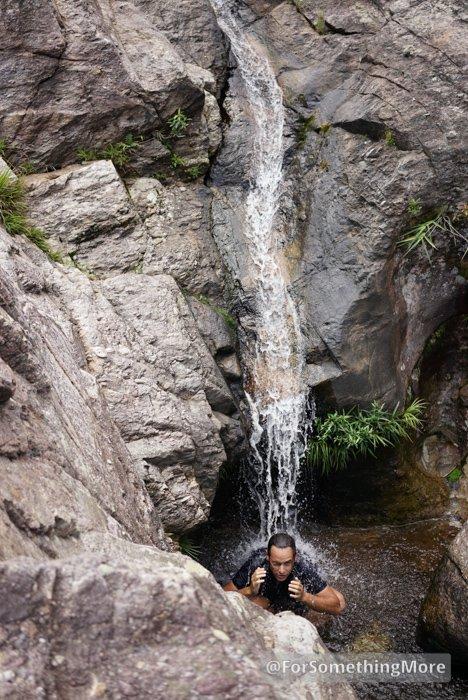 man in waterfall