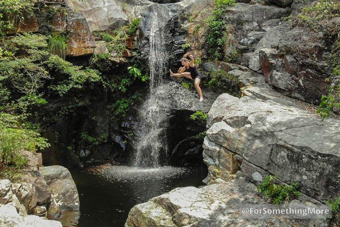 woman jumping into waterfall at Ping Nam Stream