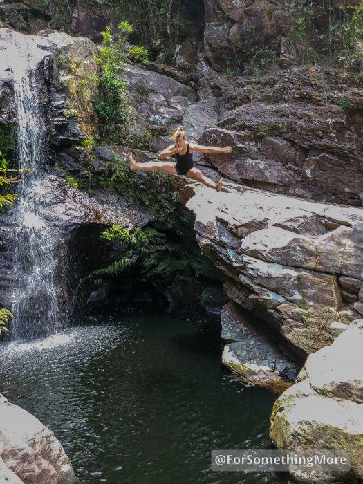 woman cliff jumping at Ping Nam Stream